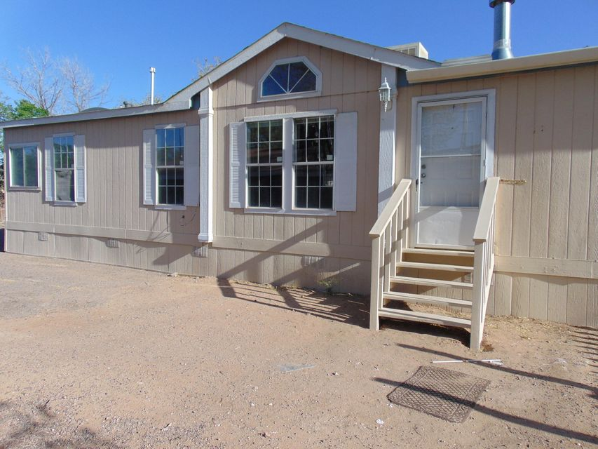 Lovely home just had a minor remodel and repair. Owner is an investor and this home was a rental. 3 Bedrooms, 2 Bath Manufactured home on an oversized lot in the NE Albuquerque area. Home has an approved Foundation and Inactive Title ready for your lender to issue funds. This home will not last at this price. Get your offer in ASAP..