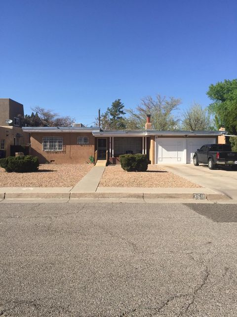 Darling Bungalow in the UNM area.Hardwood floors underneath carpet.Bathrooms with tile accents.  Large closets, lots of storage. Kitchen with plenty of cabinet space, formal dining room. Large Living room with gas log fireplace. Refrigerated cooling. Huge covered patio, for entertainment. Tremendous potential! Don't miss this one!