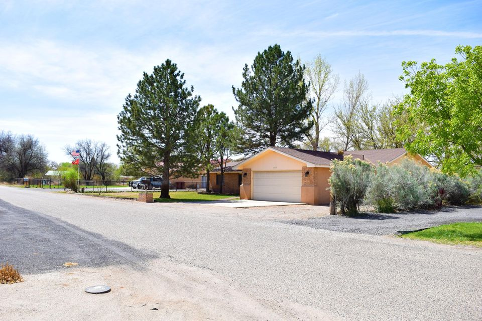 Located in the Heart of LOVELY Bosque Farms where you will find this BEAUTIFUL home that sits on 3/4 of an acre,fully fenced. This home has recently been updated with new kitchen cabinets, flooring, windows & fine looking granite counter tops. As you first walk in, you see,''SPACIOUSNESS'' since this floor plan is open and roomy. You will also find a bright Sun room where you can go and enjoy those morning or afternoon coffee, tea or just some time alone moments. Now wait! This is not all, there is also a guest bedroom with its own private bathroom. Walk-in closets, stainless steel-appliances,pellet stove,tile in bathrooms, swamp master cooler,front & back landscaped,non-covered back patio, mature trees that give great shade, lots of backyard access and is zoned for horses.