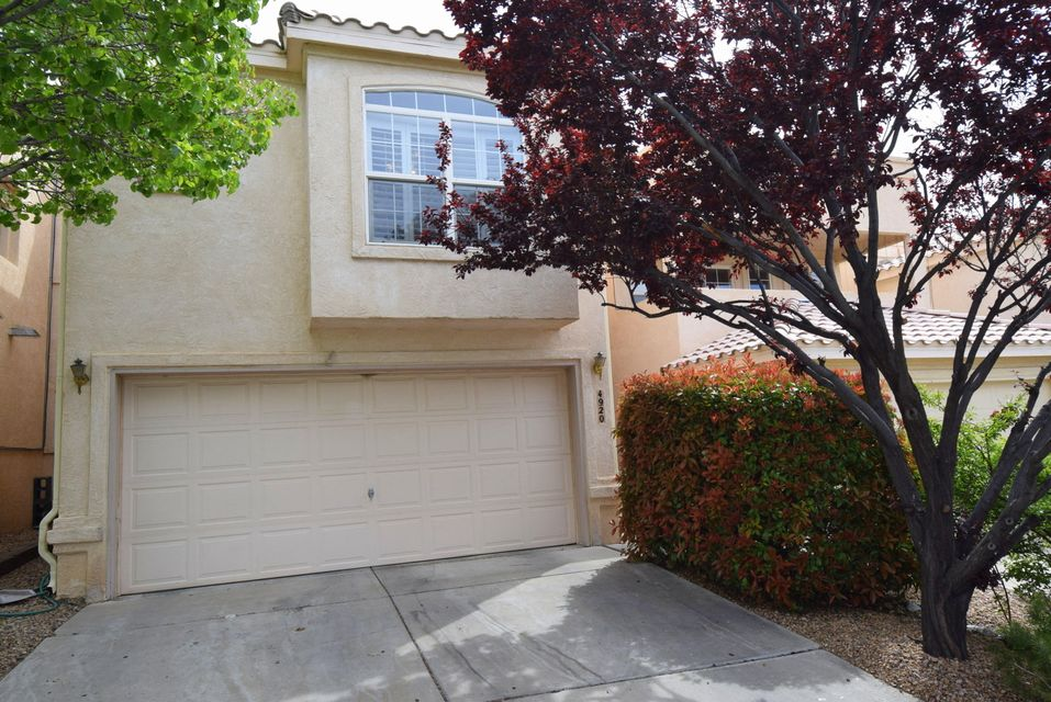 BACK on the market with inspections completed. Eldorado HS. CNM. El Oso Grande Park with playground. Running trails. Shopping. Close to it all. Pleasant townhome community.The front yard is xeriscaped while the backyard is east facing for a nice garden with grass.The laundry room is upstairs along with the three nice sized bedrooms.There are two bedrooms with attached baths.You can enjoy the covered balcony off the master bedroom. Downstairs in the roomy kitchen you will find a newer convection gas oven/stove, a newer refrigerator, microwave, and dishwasher. The ceiling fans throughout the home keep the utility bills low:about $140 a month for this family.The roof is 3 years old.The 1/2 bath is 2 years old. Location! Location! Location!  This home is ready for you to move right in.
