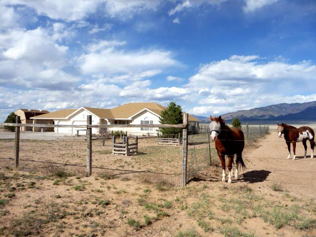 Price reduced-- under $300K for this wonderful horse property! 10 acres with amazing views & motivated seller! Bright, open floorplan, cathedral ceilings & ceiling fans, tile & laminate flooring, refrigerated air, kitchen updates. Great master suite has elegant remodeled bath with jetted tub, TWO walk-in closets, separate shower! 2 living areas (or adjacent living room & huge formal dining room?) with woodburning stove plus gas-log fireplace. Outstanding horse facilities: top-notch two-stall barn (could easily be expanded to 4 stalls!), loads of hay storage, fenced and cross fenced, run-in shed in arena/turnout area. There's also a huge, 2-story storage shed! Plenty of car space too-- 3-car garage (with own 1/2 bath!) plus 2-car carport! Easy access too-- just 1/2 mile off HWY 47!
