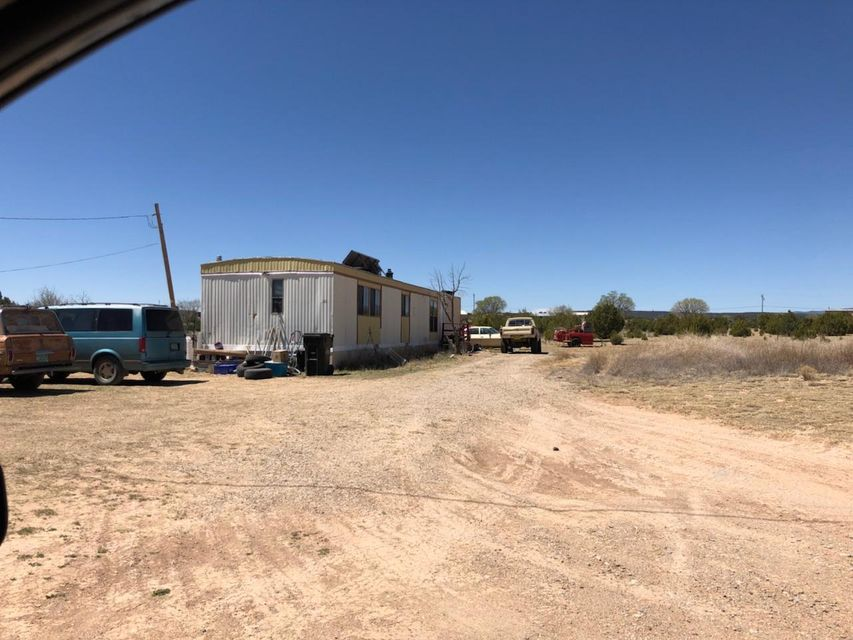 Great investment property!! Two trailers on lot both rented out.  #11 Acres Rd is a 2bd 2ba 14x16 cozy trailer with wood stove, updated carpet in living area and w/d hook ups. Rent $650 per month#05 Acres Rd is a 2bd 1ba single wide trailer also cozy and well kept with newer carpet in living area. Rent $585 per month.Both have fenced in open space area, water, electric, and propane hookups