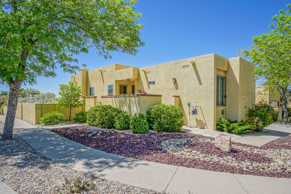 Huge executive townhome In upper NE Heights with gorgeous mountain views. Home recently has been painted and new carpet has been installed! Enjoy two separate living areas. Newer windows, roof was replaced 2009 and then resealed in 2017, saltillo tile in lower living area 2017, fruit trees. low maintenance backyard, so many updates and amenities! If you're wanting low maintenance living east of Tramway look no further!
