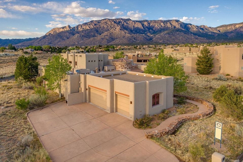 Welcome to the elegance and tranquility of your new retreat. Nestled in High Desert and perfectly positioned on the building envelope, this home captures nearly 360 views! Exquisite detail in finishes & fixtures such as sandstone tile, hardwood flooring & hand rubbed bronze chandeliers  throughout this tuscan themed residence. Kitchen features Thermador appliances, granite c/tops, butcher block island w/prep sink. The outdoor living space is your private oasis w/majestic mountain views. Built in grill & food prep area, colorful blooms grace the tranquil, bridge covered pond. Private master suite w/sitting area, oversized master bath, walk/in closets w/washer/dryer hookup and private deck w/unlimited views. Oversized 3 car garage features add'l room for workout or workshop. WELCOME HOME!