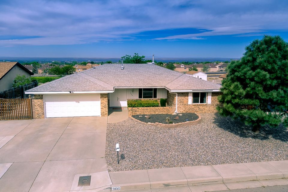 City and Mountain views, this updated open floor plan boasts both. Move in ready 4 bedroom, plus two living areas and even a formal dinning room. Newer windows, water heater, furnace, raised panel doors including French doors to backyard. Kitchen has granite with eat at counter, executive maple cabinets, stainless appliances. Baths updated with beautiful fixtures and granite. Master bedroom has walk in closet, access to patio and backyard, custom shower, double vanity with makeup counter. Other bedrooms are large with ample closet space. Crown molding, plus extra wide baseboards throughout. Backyard access with RV pad. Covered patio with skylights and a large shed in backyard. Great location to shopping, walking, hiking.