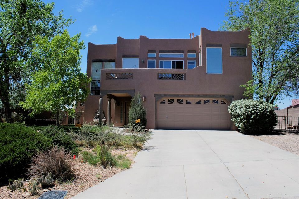 Come and take a look at this incredible move in ready 3 bedroom, 3 bathroom home.  This split level, open concept home has lots of living space and features wood floors, natural light throughout and is an entertainer's dream.  The master suite has a private deck and large walk in closet.  There is a deck off of the living room with stunning views of the Sandia Mountains.  The backyard is fully landscaped with grass, mature trees and RV parking.  This home is a must see.