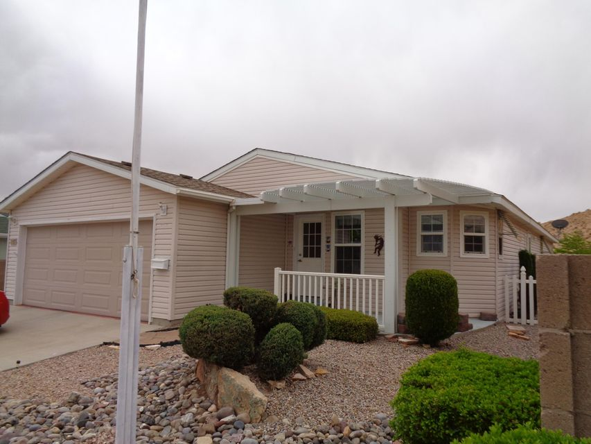Very spacious, 3 bedroom manufactured home near I-25.  Big living room, formal dining room, huge island kitchen and laundry room.  Master suite has large shower, double-sinks, walk-in closet and access to the sunroom.  Built-in Murphy Bed.  Lots of closet space.  Cathedral ceilings, plant ledges and solar tubes.  Insulated 2-car garage.  Covered porch.  Situated at the end of the road for terrific privacy.  Quick access to I-25. Gated, 55+ community has club house, swimming pool, billiards, horse shoes, exercise room...