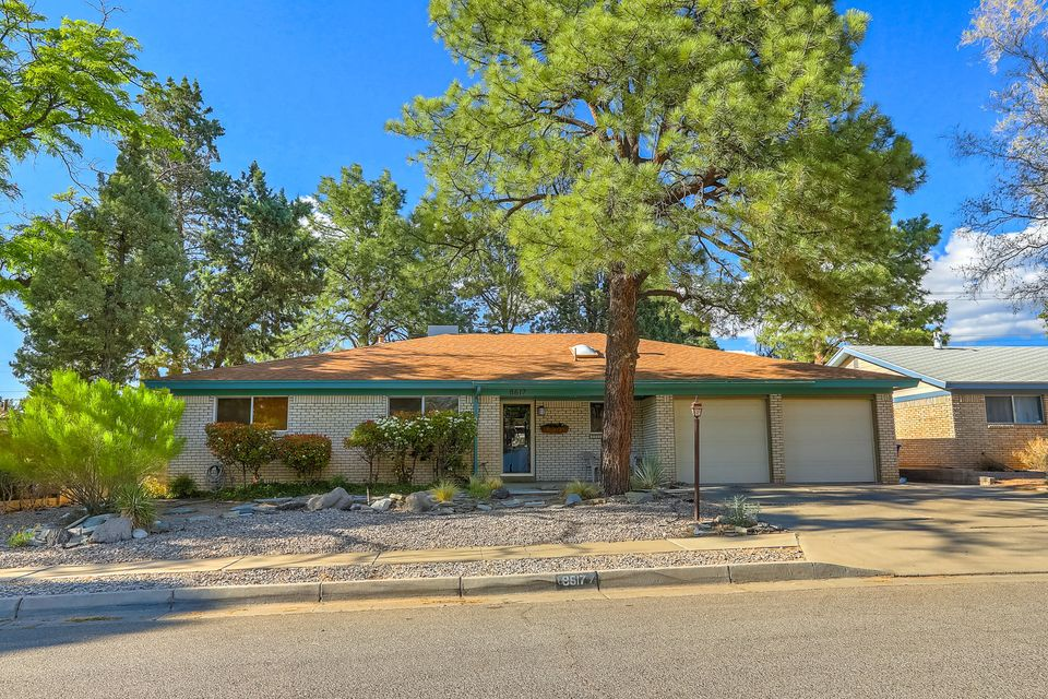 You'll love this home, the minute you open the front door. Remodeled NE gem. 4 generous bedrooms. Custom tile floors. Open living areas with tons of natural lighting.  Park like yard perfect for entertaining. Built in BBQ.  Large family room with pellet stove. Slate tile mantel / hearth. Space for everyone. Roomy kitchen with stainless steel appliances. Decorator colors and flowing floorplan. Very well maintained .
