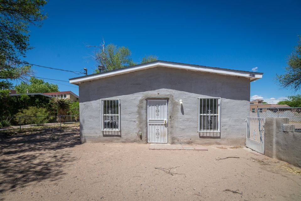 Charming southwest style home with adobe walls .The home does need a few finishing touches ,add your unique details. The home sits on a oversized corner lot with backyard access. The home has room to accommodate your RV, or work equipment.