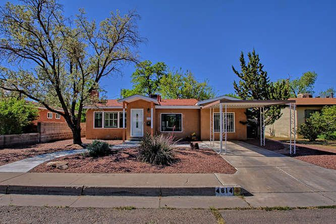 Fabulous Fringecrest cottage is an easy walk to/from Nob Hill. Lovingly remodeled inside & out with refrigerated A/C, hardwood floors, three spacious bedrooms, large eat-in kitchen, living room with wood-burning fireplace, two full bathrooms & office/den, plus a sizable laundry/hobby room. Thoughtfully designed kitchen w/ generous granite countertops plus an extra ledge to help keep counters clear while cooking. Bedrooms and living spaces all on one level with tile and solid oak flooring. Large lot w/ mature trees, xeriscape landscaping and just enough lush green grass to make the walled and gated backyard your cool urban oasis. Lots of in-home storage plus large Tuff Shed in backyard. Brand new shingled roof and metal flashing/trim. 100% move-in ready and the best value in the UNM area.