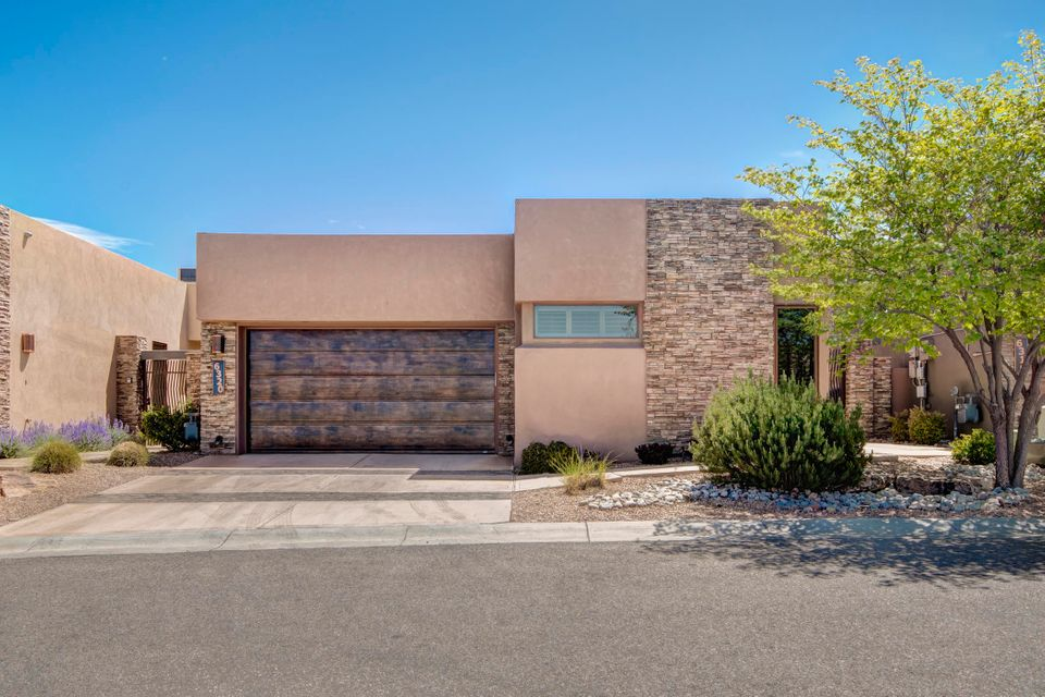 Stunning home with spectacular mountain views set in High Desert's prestigious Legends gated community. Master suite features huge bathroom with walk-in closet. Open concept living space has living room with wall of windows & contemporary kitchen featuring granite counter-tops, large pantry, Wolf 6-Burner stove & sub-zero fridge. New state-of-the-art hot water heater. Finished heated & cooled basement makes ideal media or rec room & is accessible from main living quarters. Beautiful light throughout. Gorgeous, easy-to-maintain yard & patio. Radon mitigation system already in place. Luxury living minutes from all amenities, medical facilities, restaurants & more.