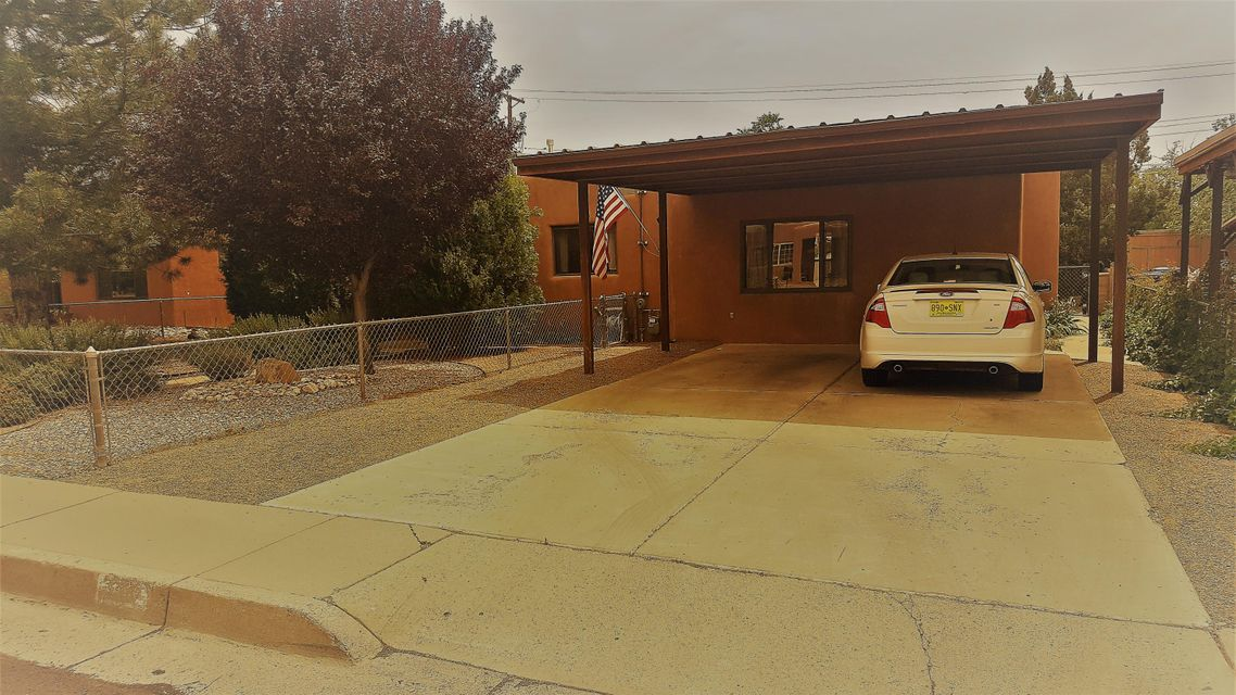 This is a great starter home or a home for someone that is downsizing. It is close to the malls, restaurants, ABQ uptown, and I-40. It is freshly painted, clean and well maintained. The home is on a quiet dead end street and has a large backyard with a storage shed. The roof is membrane/tpo installed by Lone Mountain with transferable warranty. Come take a look your first time home buyers or empty nesters.
