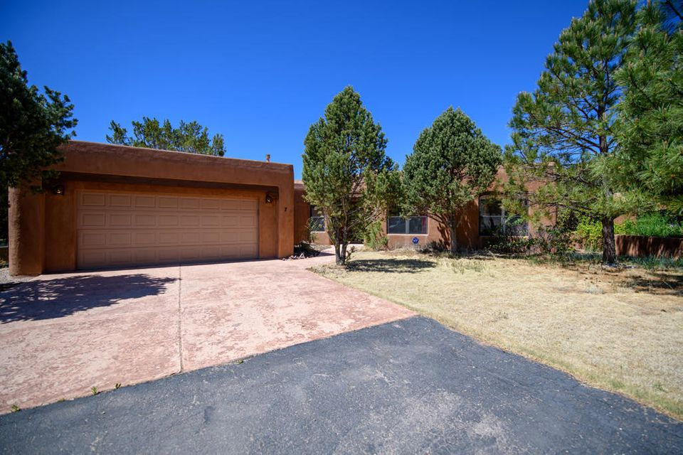 Privacy galore in this gated sub'd, yet easy commute to ABQ. Cozy Pueblo style home with community water, wood FP and wood stove for those cold nights. Covered patio/ courtyard with Hot tub in back yard. Easy mountain living, come take a look.