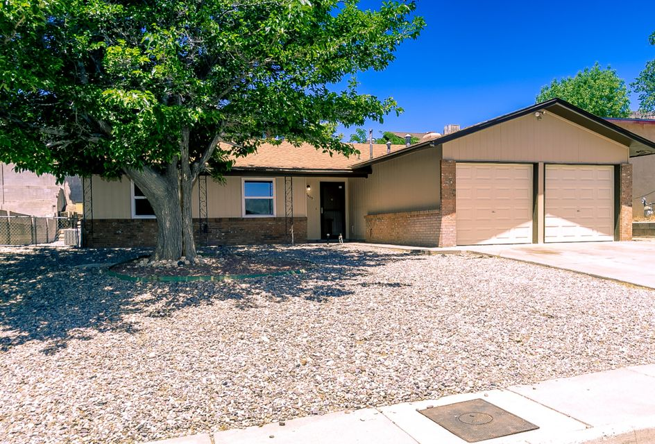 Fantastic find in the Foothills! Updates in 2018 include carpet, tile, paint, vinyl windows, bathroom mirrors, front storm door, stucco, water heater, gas range/oven, range hood and dishwasher! Very nice 1-level house with 3 bedrooms, 1.75 baths, living room, family room with fireplace, and large eat-in kitchen! (Fridge stays!) Service room, ceiling fans, skylights and plentiful storage. Two car garage. BIG backyard with open patio. Roof and refrigerated air approximately 3 years old. Mature, established neighborhood east of Tramway.