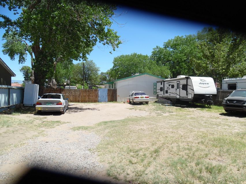 Great mobile home in a large lot. Large mature trees with fenced yard and front gate. Home has a well, no water bill!!
