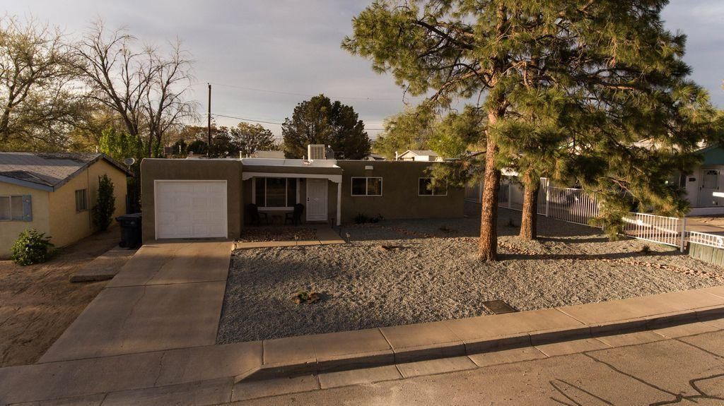 Cute little Pueblo style home with a great floor plan, large walled backyard, plenty of room for ....... A plethora of new amenities added! New stucco & roof, landscaping with irrigation, new vinyl low-E windows, tile throughout, new tile showers, new kitchen. Come check out this move in ready home, before it is too late!