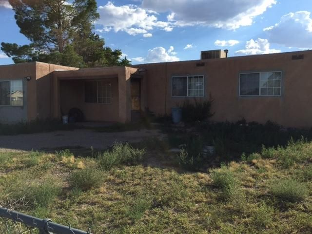 Short Sale! Almost quarter of an acre, fully fenced yard. Three bedroom, 1 and 3/4 bath, pueblo style home. Large eat in kitchen, large living room.