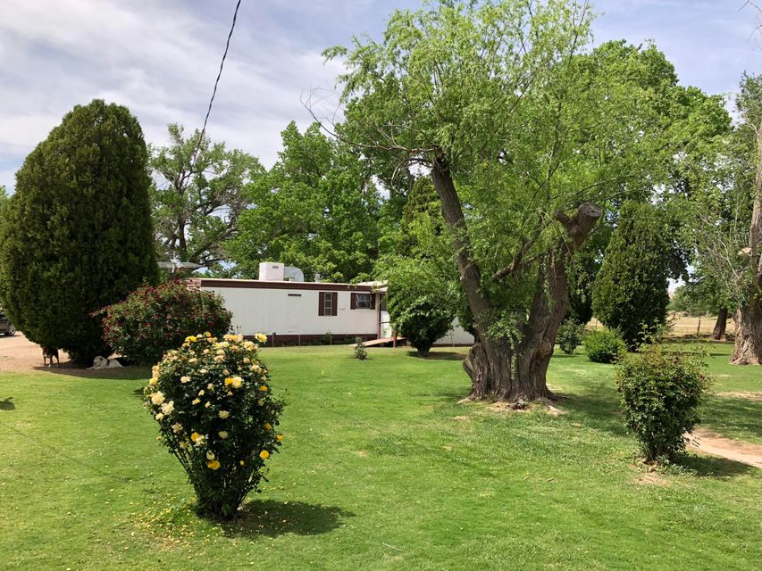 Looking for 2 homes on 3.71 Acres?Opportunity BUY!  2 separate Homes on 3.71 Acres - perfect for Extended Family, Teens, In-laws, guests...etc! Private and LUSH - Property is irrigated (30' Well), you'll LOVE the Rose Bushes and Mature Trees!  City convenience with Country Feel! Don't miss the 1 Car Garage plus 2 Sheds!  Hen house, small Barn and Corral ALL included! City Utilities! Rare find - MUST See to appreciate!  Call for details and then, take the time to PREVIEW - you'll be GLAD you did!
