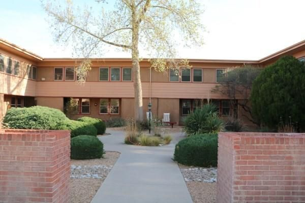 Welcome to this great property.  Hardwood flooring in the main living area.  There are 2 nice sized bedrooms upstairs.  This property has a great location close to Albuquerque Country Club.