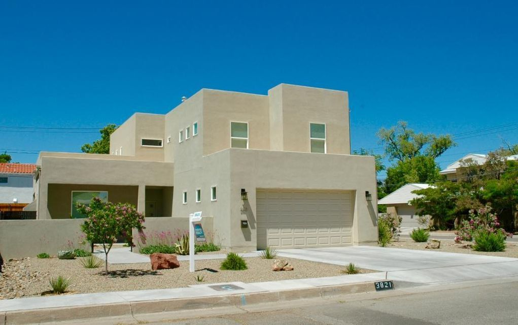 Elegant and contemporary, newly-constructed home in Ridgecrest area.  Large, secure corner lot in friendly and walkable neighborhood in great school district.  Close to UNM, Nob Hill and downtown.  Bright, sunny home with open flooplan and large, fenced backyard.  Finished two-car attached garage and plenty of room for secure off-street parking.  This home is the perfect place to entertain and enjoy the high desert lifestyle. Transferable New Home Limited Warranty.