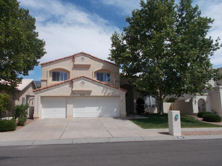 Lovely, light-filled home in the Far NE Heights near the foothills and Bear Canyon Arroyo. Spacious eat-in kitchen with granite counter tops, built-in oven, and center island, opens to family room/den. Two living areas and formal dining room. Large master bedroom with sitting area, balcony w/ mountain views and fireplace. Master bath with garden tub, separate shower, double sinks, water closet and large walk-in closet. Lower level bedroom and 3/4 bath. Loads of storage space throughout home. Beautiful custom window coverings, including plantation shutters. 3 car garage. Lush backyard with grass, native shrubs and plants, storage shed and covered patio. Overall, this home has been impeccably maintained and cared for.