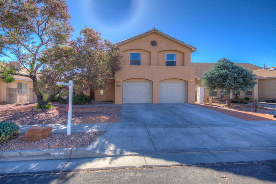 Beautiful 2 story home on the West side of Albuquerque. Open light and bright with fresh new paint. Enjoy the open floor plan with big eat in kitchen that opens to great room with a cozy fireplace. Up stairs enjoy 3 spacious bedrooms with study area. Huge master suite with sap like bath big soak tub. Large walk in closet with views off master walk out deck. Enjoy the added bar or man cave great for get together's 2 car garage. Must see this gem...
