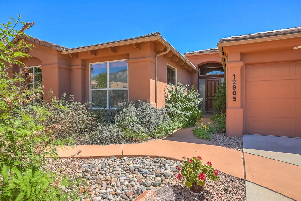 Big, beautiful single-story Mechenbier on one of High Desert's loveliest streets. High ceilings and huge windows distinguish the two spacious living areas. A chef's kitchen opens to a family room with stone fireplace and tasteful touches throughout.  Inspections complete.  Four bedrooms plus study, and an additional office area make room for everyone. Bring us an offer!