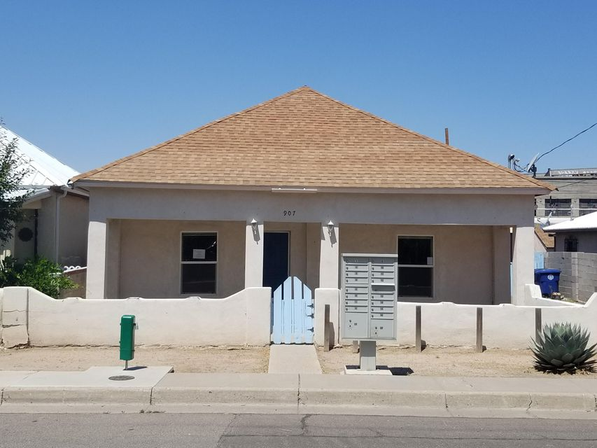Beautiful Partially Rebuilt Home In The Heart Of Albuquerque. What a great central location: Close to downtown, railroads, major highways, stores, and schools. The home shows many improvements. Minutes From UNM. Close To City Park With Playground. On Bus Line. Huge Back Yard With Storage shed that needs to be re-built. Possible teen quarters. Car Port Area Provides Back Yard Access. Check out this home on a large lot with wood floors and an open living area, 2 bedrooms and 2 FULL bathrooms. This home needs work. There are structural issues. See Structural Report under Documents in the MLS. Seller will not complete any repairs to the subject property, either lender or buyer requested. The property is sold in AS IS condition.