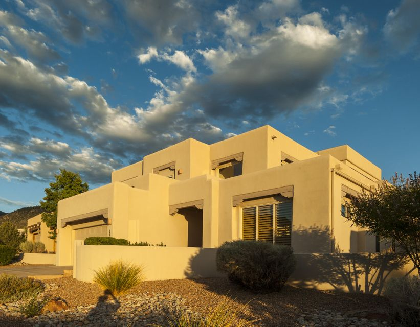 Wow what a great home built by Scott Patrick with expansive City Wide Views, Home backs to Bear Canyon Arroyo Open Space with great updates. Wood floors, Kitchen with updated cabinets w/organizer by org., gourmet island with apron sink and great gourmet stainless appliances including gas range, wine coolers automatic open microwave and bkbar. Main level in-law suite or 2nd living area with full bath access and backyard access. Curved Staircase to the Master bedroom, Master features Custom cabinets, Closet done by org and Huge expansive City view deck. Spare bedrooms have view deck of the Sandias. Backyard features great outdoor living with Built-in BBQ, Fire pit, Hot tub and Xeriscape to take advantage of the wonderful open space and mountain and city view.