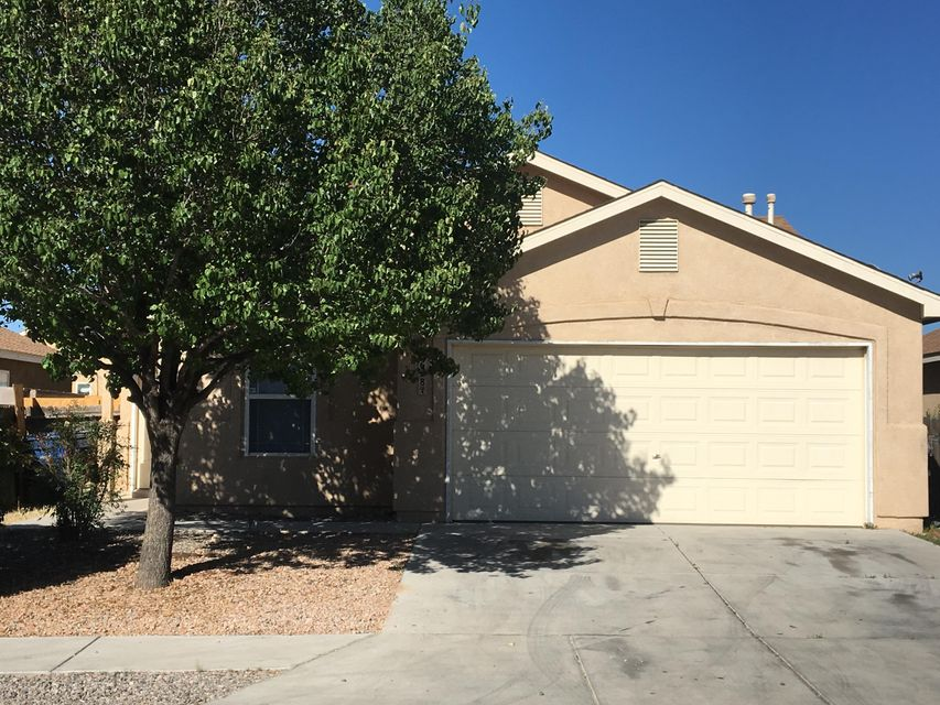 Newer house with 2 spacious bedrooms near Rio Grande and Coors.  Nice wood flooring in bedrooms.  Tile in kitchen, laundry and bathrooms.  All appliances in home will stay.  High cathedral ceiling in living room.