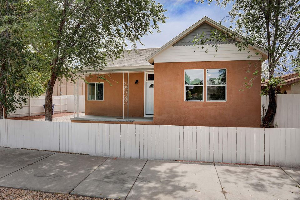Beautiful remodel, on two city lots with backyard access in the heart of Albuquerque. New everything, roof, electric, hot water, HVAC/ refrigerated air, granite counter-tops, stainless steel appliances, low E windows, refinished hardwood floors, tile, bathrooms, vanities, light fixtures, cabinets, stucco, ceiling fans in every room, the list goes on. Xeriscape front and back, fenced yard. This house will not last long. Come take a look.