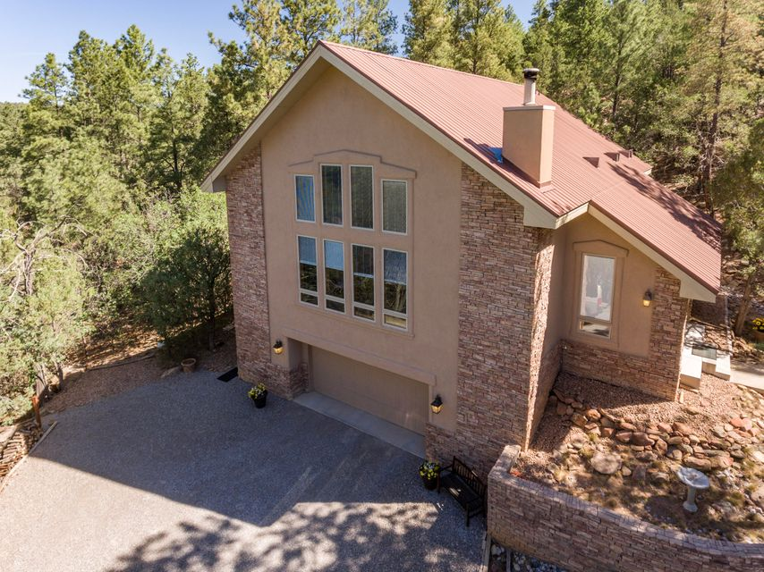 Just imagine pulling up and thinking - We are LIVING the Dream! Nature Lovers/Privacy Lovers Dream come true! This beautiful ONE OWNER, Top Shelf, Crombie home is nestled in the heart of 100's of Ponderosa Pines!  Soaring ceilings, master downstairs. massive wooden beams and T&G ceiling; 25 foot vaulted ceiling with panoramic view of forest. On the water system! Property is adjacent to over 300 acres of State owned open space! Additional 1000 sq ft basement NOT included in the sq ft, it stay's the same wonderful temp all year! AND it comes with the most adorable guest cabin you can imagine! Tree house and swing sets, and countless trails to explore Gods country! Additional 7.5 acres available for purchase see MLS 921234 to purchase this home on 10 acres