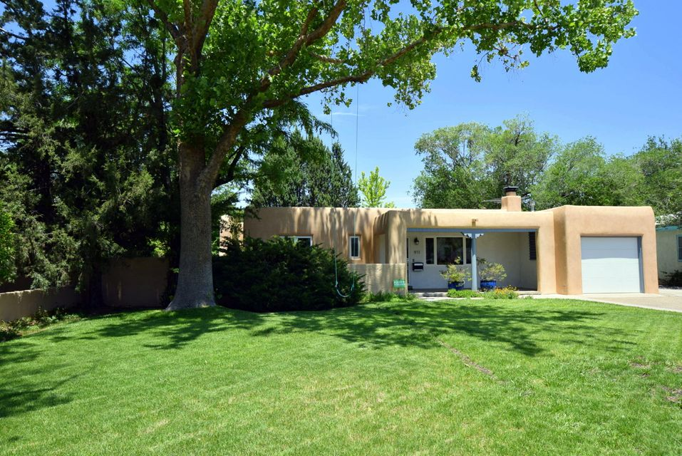 This delightful freshly painted 4 bedrooms,3 baths pueblo style charmer that rests on an over sized lot will make your dreams come true.Nestled under an awning of trees this home offers a rocking chair front porch.Step into the living room with gleaming hardwood floors(refinished in 2018)and the dramatic kiva fireplace.(chimney swept in 2017)The custom kitchen/dining room will take your breath away with the open floor plan.Jenn-Air appliances,range with down draft,custom Redbirch cabinets,granite counter tops food bar for stools.Italian iridescent glass back splash,custom task lighting and ceilings and large format Spanish porcelain tile flooring.This architectural design flows thru the house.Walls of windows take you outside to this stunning unusually large yard with outdoor living.WOW