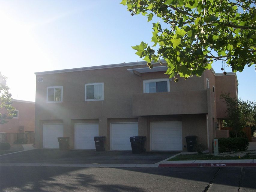 Beautiful 2 bedroom, 2 bathroom condo in a peaceful gated community.  Open floor plan for kitchen, dining and living area.  New tile in all wet areas! Bedrooms are large.  Master walk-in closet, 3/4 bath. Mountain views from the balcony! Washing machine is new! Service area very convenient.  Plenty of storage in this condo.  Excellent location too! Single finished one car garage with extra storage. HOA covers some utilities, insurance and care for common areas, roofs and stucco.