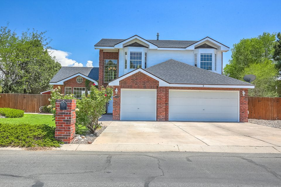 Views, Views, Views!!! Check out this magnificent property by the golf course with beautifully landscaped front and backyard. As you enter the house, a welcoming view of the golf course will entrance you, both from the dining area, kitchen and the living area. The kitchen is a winner!   It affords the convenience of putting your culinary and hosting skills to use. If you want to entertain in style, this home is perfect! The fireplace in the master bedroom and the view deck give it a feel of a romantic get-away. Sit and watch the views of the Sandias and the golf course on the covered back porch and enjoy the sound of the water running down the pond while you sip your favorite drink. This home has so much to offer. New carpet and move in ready!  Make this home yours and make and offer now!