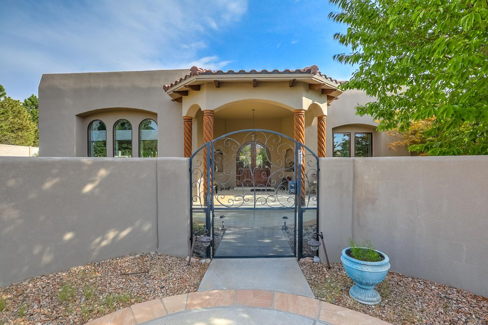 Stunning Custom Panorama single story hm with a 4 1/2 CG w/enclosed car bin on a private beautiful landscaped lot. High ceilings, wood floors, custom tile work, handmade wood doors w/hand forged iron hardware, shelter wood windows, arched doorways, 5'' custom baseboard, tankless water heater, lighted niches, built-in vacuum system & more! Great room boast 14' ceilings w/extra wide crown molding, double arched entry & custom FP. FDR w/custom lighting & designated hutch area. Gourmet kitchen w/granite ctp & 8 x 6 island, custom skylight w/aged copper effect, natural cherry custom 42'' cabinets w/pull outs plus butlers pantry and built in desk area. MBR suite has attached sitting rm w/built-in coffee/wet bar & gas log FP. Enjoy the backyard oasis w/covered patio areas and quiet gardens.
