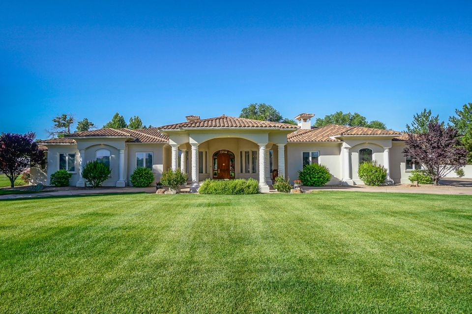 Exquisite Stunning Craftsman Built Masterpiece in The quiet tranquillity and private setting in the North Valley.Single story home on a premier 2 acres of Luxury living.Custom throughout.Charm eludes this home.From the stunning curb appeal to the grand entry ,open floor plan with walk out french doors to the glorious expansive outdoor entertaining back yard not to miss mentioning the breathtaking views of the Sandias.No monies spared on the quality of this home with Ernie Torres cherry  cabinetry,beautiful custom (4 piece design for that majestic look. mouldings throughout,Imported Italian Marble flooring ,high end  appliances,Cambrian Black Granite in kitchen,Schoenbeck,Strauss crystal Chandeliers , Gold leaf Medallions in living room and copper leaf in dining room,Owners suite is a ''10'