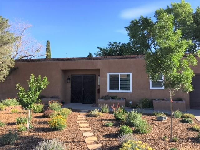A great ranch style home on a quiet street in desirable NE neighborhood. Open its doors into a unique and lush atrium. Features spacious bedrooms, completely remodeled kitchen with quartz counter tops, updated bathrooms with double sinks, new double-pane windows, and a xeriscaped front yard. A shady back yard is perfect for relaxing and entertaining with sprinkler and drip system, two sheds for storage. Excellent schools, close to the park and shopping!