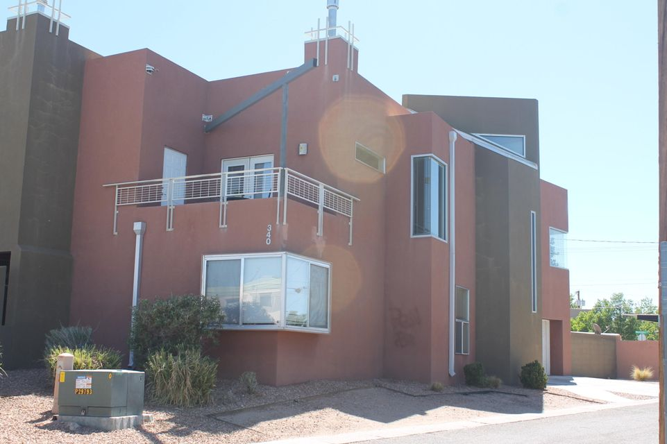 TWICE THE SPACE OF MOST CONDOS.  PRIVACY AND NO CONDO OR HOA FEES.  THREE LARGE BEDROOMS WITH WALK-IN CLOSETS AND CEILING FANS.  MODERN CONTEMPORARY DESIGN WITH ANGLED WALLS AND WINDOWS.  OPEN LIVING, FIREPLACE, BALCONY, TILE AND CARPET.  GRANITE COUNTERS AND STAINLESS APPLIANCES. REFRIGERATOR AND WASHER /DRYER STAY.  JACUZZI TUB IN MASTER BATH AND SEPARATE SHOWER. AWESOME NOB HILL LOCATION AND BANDELIER SCHOOL.