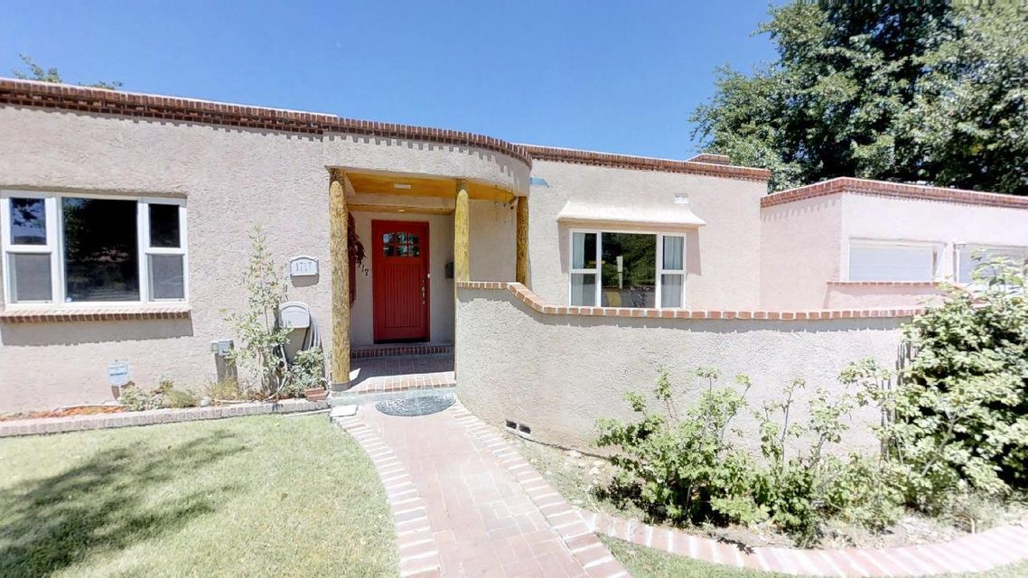 This move in ready home is in one of Albuquerque's most beautiful neighborhoods. The kitchen and hall bath have been updated and feature granite counter tops and stainless steel appliances.  The recently added master bedroom has separate his and hers bathrooms and closets.  It has a two car garage in front for everyday use and a two car garage in back with large work area and plenty of outdoor parking. The second garage has hot and cold running water to the far corner for potential future renovations.