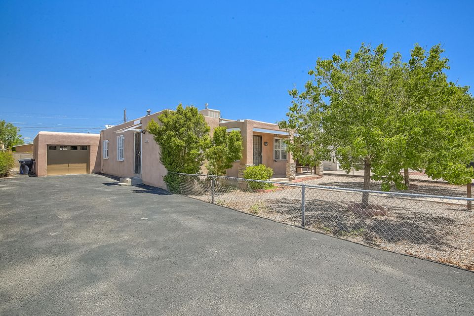 Wonderful single story home located near North Valley area.  Home Features - Updated Kitchen, Wood and Tile floors, 2 living spaces, large bathroom with double sinks, wood burning fireplace, large laundry room area,  spacious backyard with gazebo, custom exterior fencing and gates and much more!