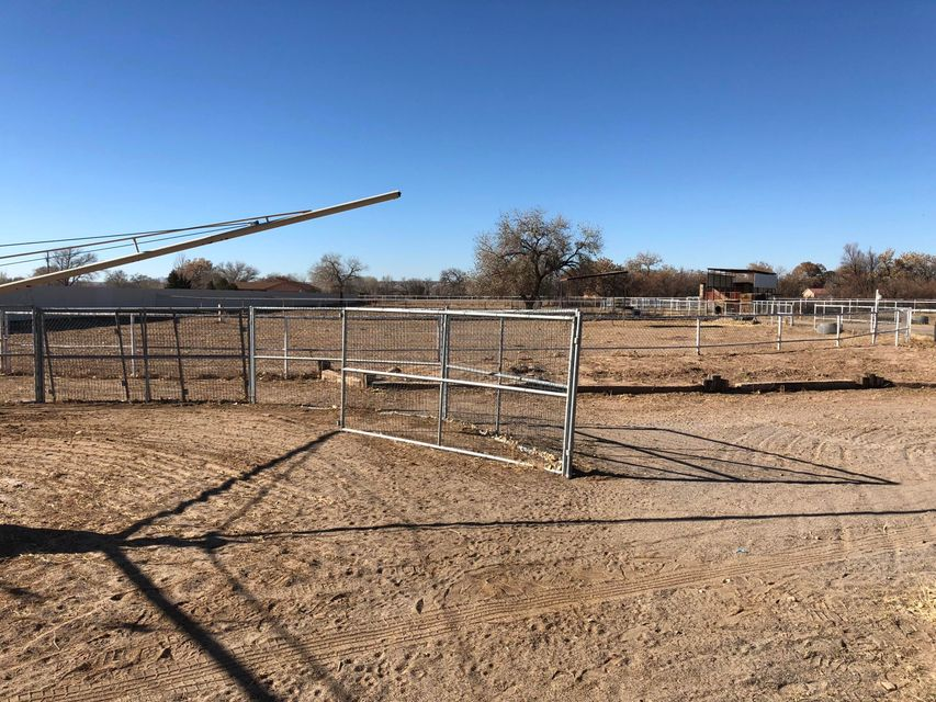HORSE PROPERTY!!!  Horse lovers dream, with three individual acres, all piped fenced with a 10 Barn Horse Stall, Tack Room, Horse Walker and a 2X4 mesh horse fence.  The home is used primarily as an office.  Call today and schedule your own personal tour.
