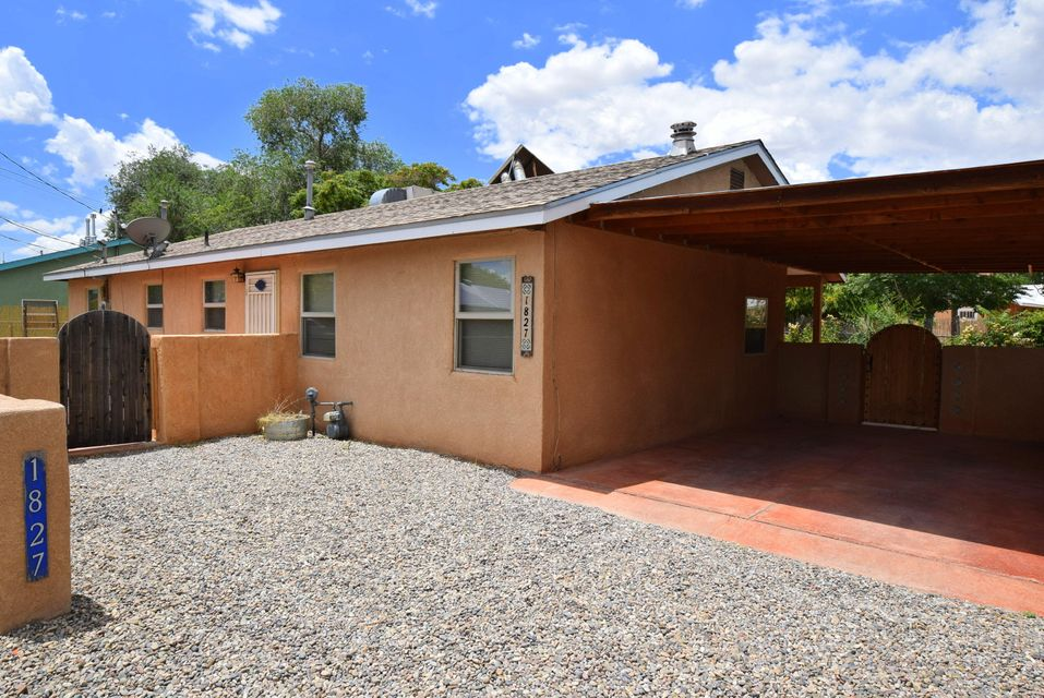 Open SAT 2:30 to 3:30! A delightful, tranquil, 3 bedroom, 2 bath, pastoral North Valley charmer.  Move in ready.  Functional floor plan.  Spacious rooms, fun great room.  Front and back liveable outdoor spaces and side yard that beckon the gardner.  Meander along the quiet local roads here. Enjoy the meadows, goats and peacocks. Walk not even a quarter of a mile to the green grassy Los Duranes park and Community Center.  Separate and spacious laundry room, great closets.  No HOA, not far from UNM, nice investment opportunity!