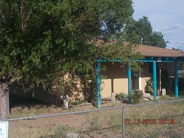 This is a very attractive and comfortable historic adobe remodel. New cabinets and countertops.  New tile and carpet. Mostly wood floors.  New heating and cooling unit with refrigerated air.  New hot water heater. New roof in 2012. Newer well equipment and septic.  Lots of light and plenty of room to raise a garden and animals. Back patio perfect for cookouts. All fenced and includes a dog breeding and kenneling building.