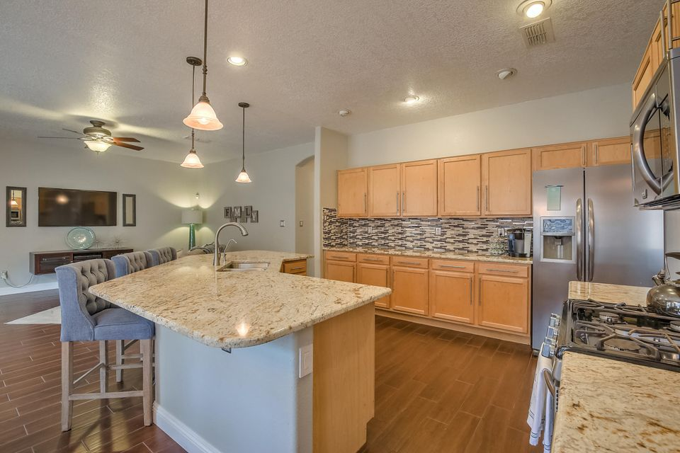 Beautiful modern updated home in Paradise Knolls. 2900 square feet, 5 bedrooms, 3 bathrooms. One of those bedrooms as well as one bathroom is downstairs! Updates include all new wood look tile throughout as well as carpet. Stainless steel appliances including refrigerator, granite countertops, 5'' baseboard. Brand new water heater and washer/dryer stay! Home also has a water softener and RO system. Talk about move in ready! Park down the street, shopping and restaurants close by.