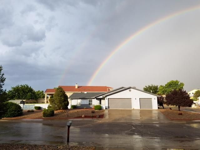 Your pot of gold at the end of the rainbow. Unique and versatile home in an exclusive golf course area.  Both a comfortable great room design plus a private living area.  Large sun room, big enough to dine and entertain in.  Lovely southwest features and colors.  Corner lot easy to maintain lot. 3 car garage for the growing family (or car buff).  This is a must see for your pickiest buyer.  Owners are immaculate.