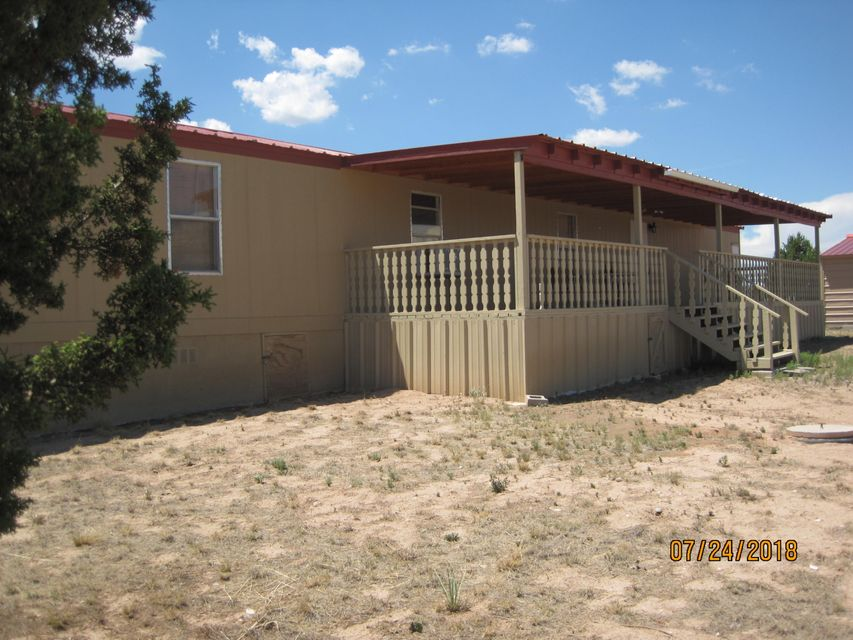 Come to the country. Bring your horses. Five acres fully fenced.  Forever views to the east.  Super large covered deck 45 x 10. This is a very well maintained home.  Large shop/garage 30 x 30. Seller will not pay for any closing costs or inspections.
