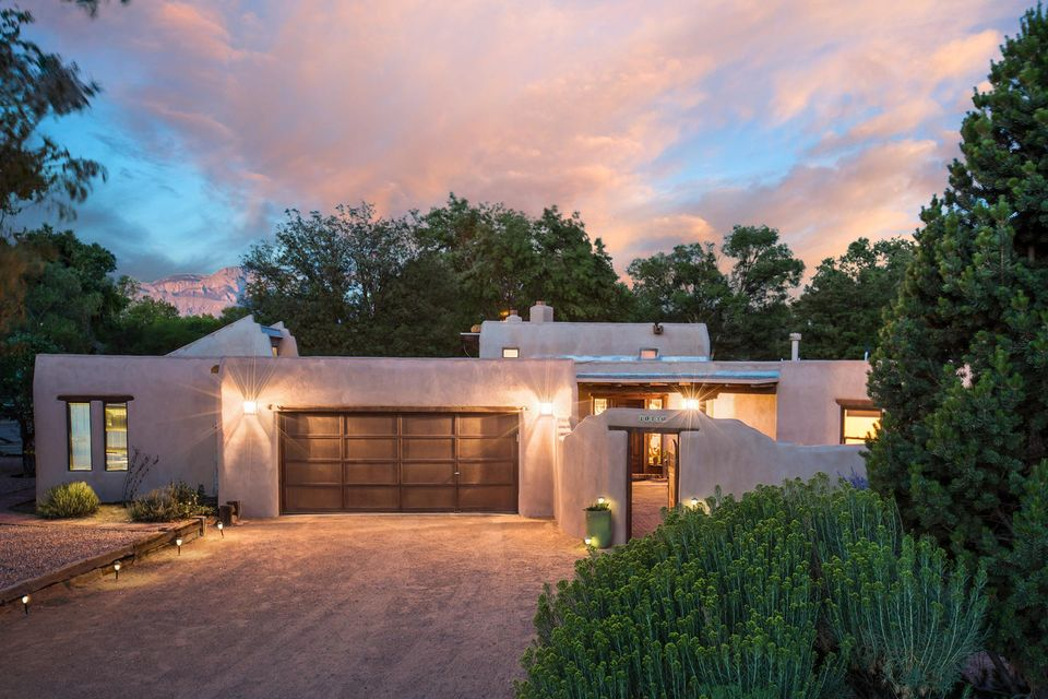 This unique home is sure to please from the amazing interior adobe walls and bancos to the beautifully designed Al Knight Kiva fireplaces - there are two, one in the Owners Suite and one in the large living area. The Owners Suite boosts Karastan New Zealand wool carpet, (so gentle on the feet) walk in closets and over sized dressing room or office with outside entrance, Kiva fire place and sitting area or hobby room. The 4th and 5th bedrooms are a perfect retreat for in law or teenage quarters with its private entrance and pergola.The Outdoor Kitchen promises many happy  gatherings. The tall bird bath fountain  in the yard adds to tranquility to this home. Horse barn, arena, raised garden beds, grass area, tress, fruit trees, riverbank access, back-yard access,