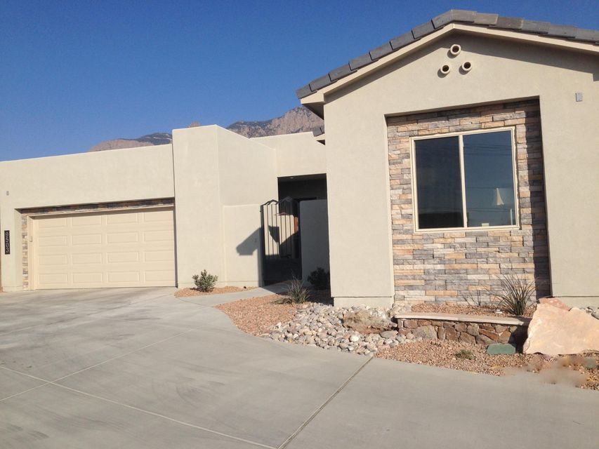 Under Construction this new Custom Scott Patrick Home has spectacular views of the Sandia Mountains.  Some of the home features include walk in Butler pantry, kitchen island, granite countertops, stainless steel appliances, front yard landscaping  including sprinkler system  with timer, garage automatic openers with one keypad and much more. Mandatory HOA fees to North Tramway Homeowners Association in the amount of 25.00 per month.  Additional HOA fees to Sandia Heights Homeowners Association with an additional 8.00 per month.