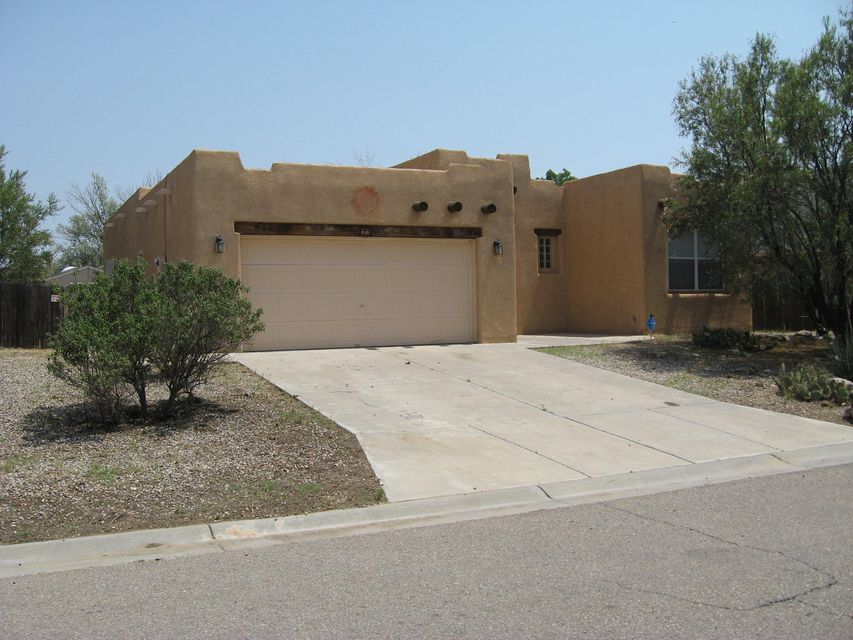 Beautiful Pueblo style home with nice layout located in the nicely planned Las Maravillas subdivision.  Open floor plan with master bedroom separated from the other bedrooms.  Nice large family room with kiva gas fireplace.  Back covered patio and laminated and tile flooring thru most of the home.  Comes with a 10x12 storage shed.  Southwest landscape which affords low maintenance.  Newly replaced AC.